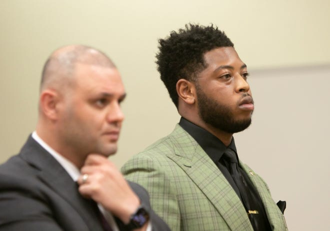 Rep. Jewell Jones, D-Inkster, stands with his attorney Ali Hammoud before Judge Daniel Bain in a motion hearing held in Livingston County Thursday, June 24, 2021.