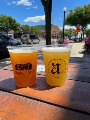 Seven downtown Howell restaurants are participating in the city's newly established social district for outdoor alcohol consumption, including Aberrant Ales. One of the rules is alcohol has to be in special cups, like the ones pictured.