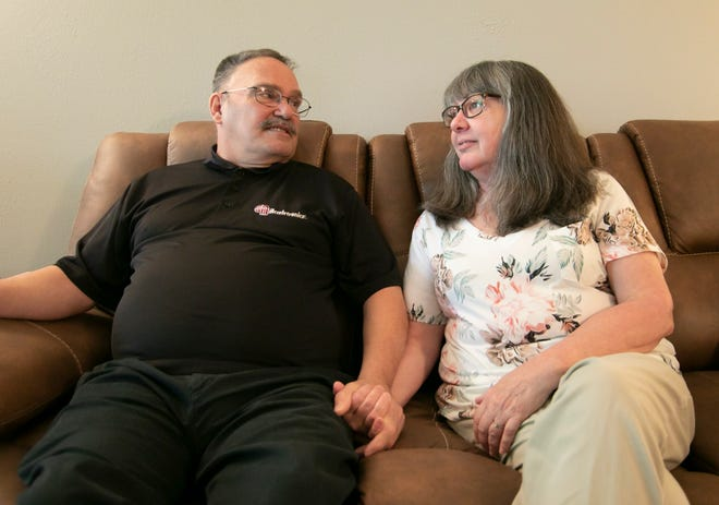Joel Heavern, seated next to his wife Lori in their Howell home Thursday, June 24, 2021, talks about going through treatment for prostate cancer this past year during the pandemic.