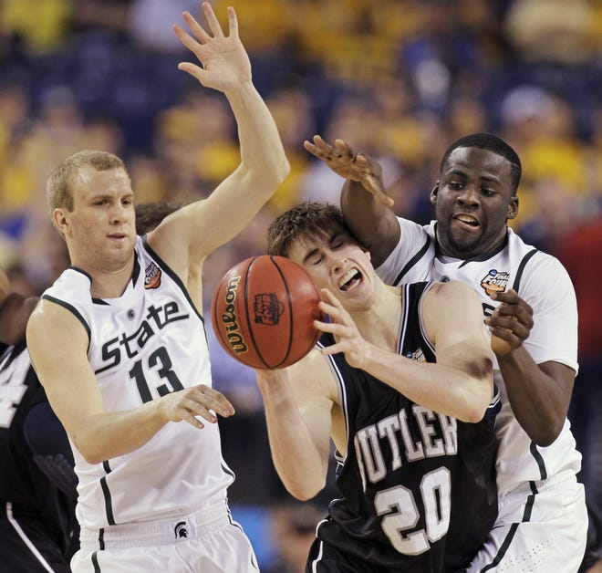 Butler's Gordon Hayward (20) is defended by Michigan State players Austin Thornton, left, and Draymond Green, right, during the second half of a men's NCAA Final Four semifinal college basketball game Saturday, April 3, 2010, in Indianapolis. (AP Photo/Darron Cummings)