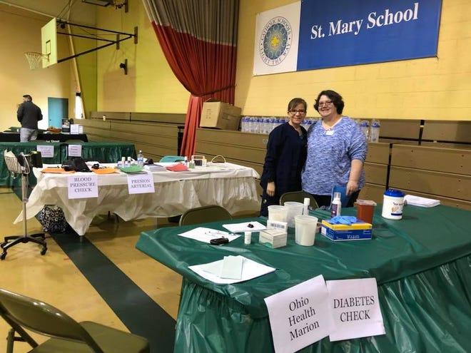 St. Mary Church member Martha Stefanka with an OhioHealth nurse at the church's Latino Health Fair in 2018.