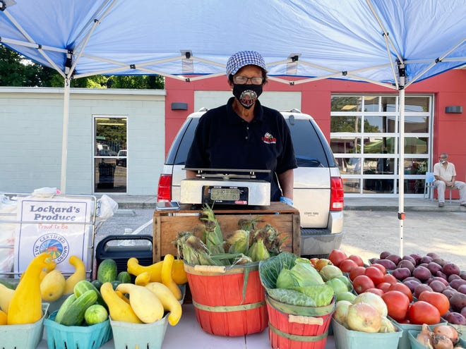 Debra Lockard, owner of Lockard Produce sells Certified Naturally Grown produce, including squash, cucumbers, onions, shallots, potatoes, greens, corn, and her prize-winning tomatoes.