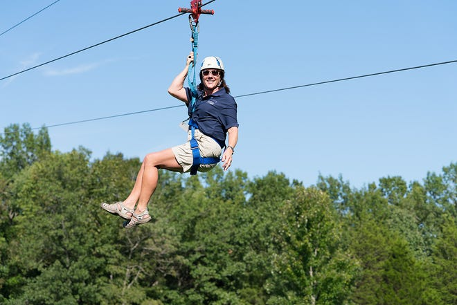 Leadership Middle Tennessee 2019 class member Brenda Hogan on a zip line as part of the nonprofits activities.