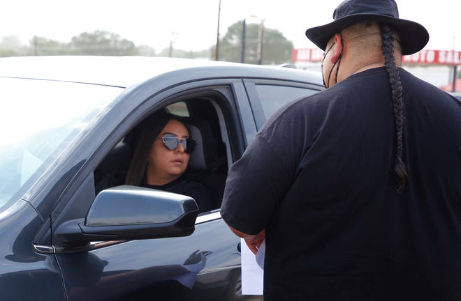 Josephina Brown, left, registers for Shiprock Just Move It at the program's drive-thru event on June 23 at Berg Park in Farmington.