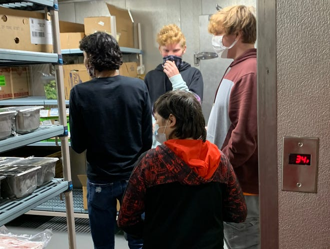 Port Clinton students tour the local Wendy's location as part of a job orientation. As the students begin earning their own money, they will be in a better position to manage the income through the school's financial literacy program.