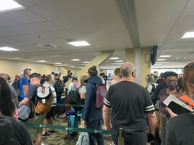 Passengers line up at the TSA security line at Reno-Tahoe International Airport on June 13.