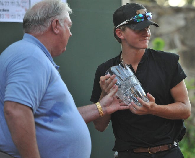 Coronado golfer Preston DeFriend accepts his award after the final round of the Texas-Oklahoma Junior Golf Tournament this week at Wichita Falls Country Club. DeFriend won the open division championship, the third year in a row he's won his age division in the tournament.
