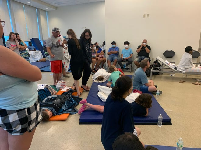 Family and friends await news at the American Red Cross reunification site June 24 in Surfside, Fla.