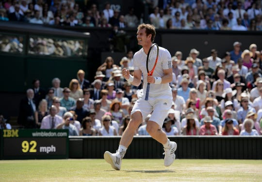 Andy Murray plays against Novak Djokovic on Centre Court during men's singles final at Wimbledon in 2013.