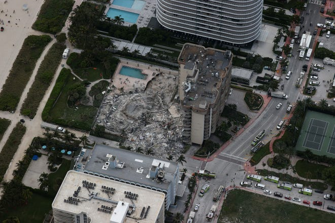Search and rescue personnel work in the rubble of the 12-story condo tower that crumbled to the ground after a partial collapse of the building on June 24, 2021 in Surfside, Fla.