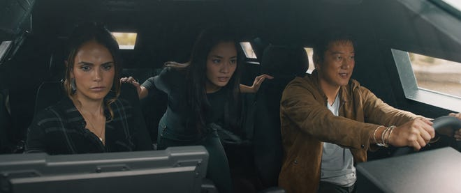 """Mia (Jordana Brewster), Elle (Anna Sawai) and Han (Sung Kang) chase some bad guys in """"F9."""""""