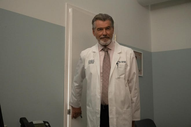 Lucy suspects the charming but bewildering Dr. Hindle (Pierce Brosnan) has ulterior motives.