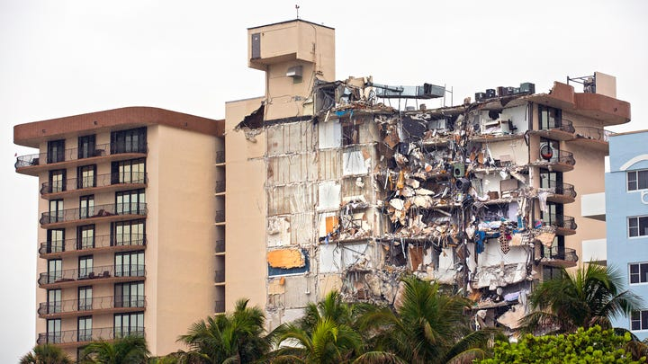 The partially collapsed Champlain Towers South condo is pictured in Surfside, Florida. Families wait to hear news about their loved ones as rescue efforts continued late Thursday
