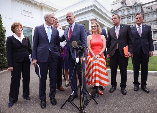 WASHINGTON, DC - JUNE 24: President Joe Biden (C), joined by from left to right, Sen Jeanne Shaheen (D-NH), Sen. Rob Portman (R-OH), Sen Bill Cassidy (R-LA), Sen. Kyrsten Sinema (D-AZ), Sen. Mark Warner (D-VA) and Sen Mitt Romney (R-UT), speaks after the bipartisan group of Senators reached a deal on an infrastructure package at the White House on June 24, 2021 in Washington, DC. Biden said both sides made compromises on the nearly $1 trillion infrastructure bill. Biden was joined by,  . (Photo by Kevin Dietsch/Getty Images) ORG XMIT: 775672000 ORIG FILE ID: 1325284234