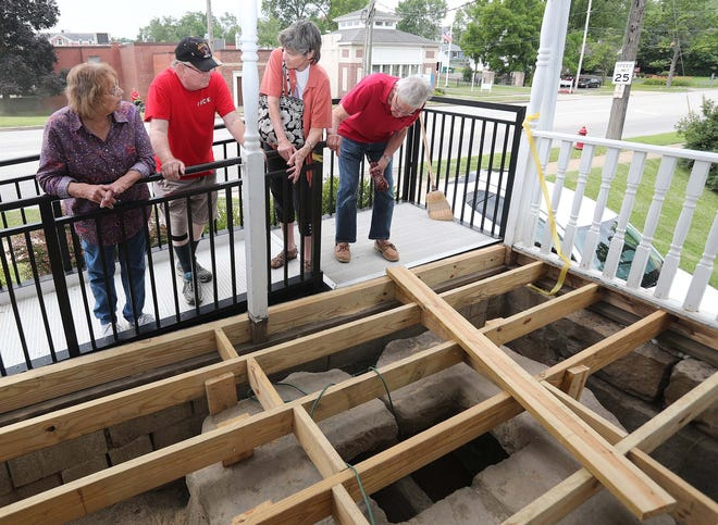 Gis and Ken Roddie, left, and Audrey and Ed Kancler, all of the Twinsburg Historical Society, check out the cistern that Christine and Steve Gotch, owners of the Greenbridge Teahouse Bed and Breakfast, found during a recent renovation.
