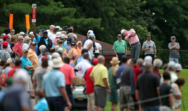Fred Couples draws a large crowd as he tees off on No. 8 during the second round of the Bridgestone Senior Players Championship at Firestone Country Club on Friday. Couples said having the fans back after missing them last year is a huge boost to the players and the overall atmosphere. [Jeff Lange/Beacon Journal]