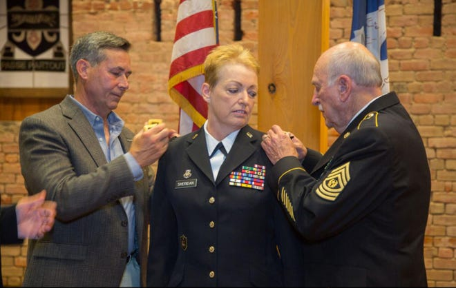 Louisiana National Guard Maj. Gen. Joanne F. Sheridan's husband and father remove her old rank and replace it with the new Ansel M. Stroud Military History & Weapons Museum at Jackson Barracks in New Orleans, July 23, 2017. In her new role as the assistant adjutant general, she now serves serves as a principal advisor to the adjutant general. She is responsible for assisting the adjutant general in the deployment  and coordination of programs, policies, and plans for the LANG