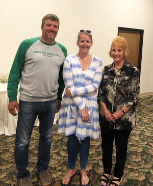 Rotary President Bob Magsam honored co-Rotarians of the Year Jess Bengtson and Krista Proulx at the club's year-end banquet at the Crookston Inn