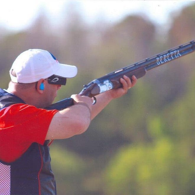 Steve Schubert, a dispatcher for the Guernsey County Sheriff's Office and champion trap shooter, competes in a trap shoot competition.