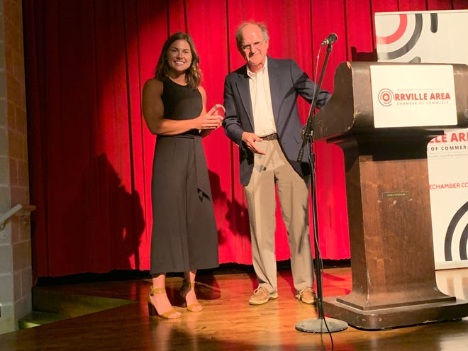 Dr. Andrew Naumoff presented Lexi Nussbaum, general manager of Zephyrs Fitness and CrossFit Orrville, with the Dr. Andrew Naumoff Healthy Habits Champion Award.