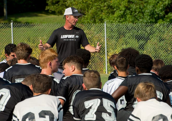 Ledford head coach Chris Adams talks to his team during a break in practice prior to the 2019 season. Adams resigned as both football and baseball coach on Thursday to accept a position as an assistant principal at East Davidson. [Donnie Roberts/The Dispatch]