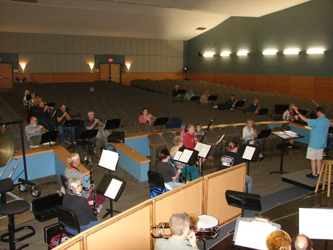 The Hornell Area Wind Ensemble rehearses in the Hornell High School auditorium for its comeback concert set for July 2 at the Broadway Mall.
