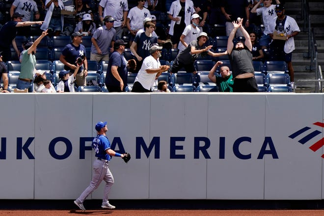 Kansas City Royals right fielder Ryan O'Hearn, lower left, watches as a home run by New York's Aaron Judge sails into the seats in the Yankees' 8-1 victory Thursday afternoon.