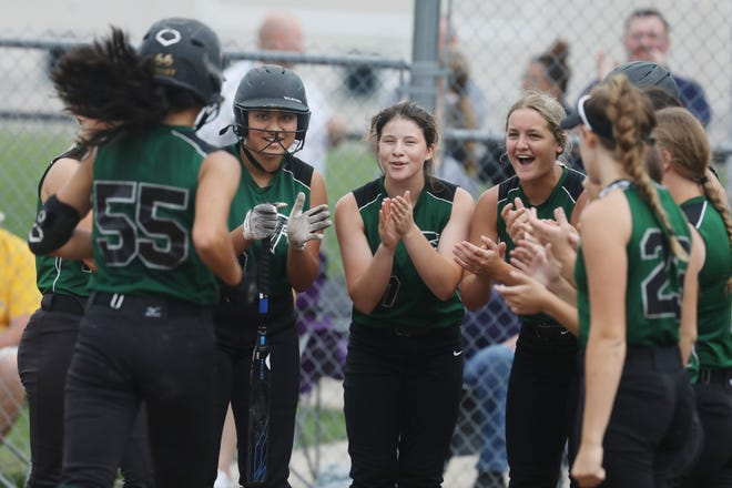 West Burlington-Notre Dame's Logan Kelley (55) is congratulated by teammates after hitting a home run during their game against Central Lee High School Thursday June 24, 2021, at West Burlington's Barb Carter Field. West Burlington-Notre Dame won 12-0 after three innings.