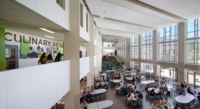 The Town Square space inside the main entrance of Dover High School and Regional Career Technical Center is a popular gathering spot and the heart of the school community.