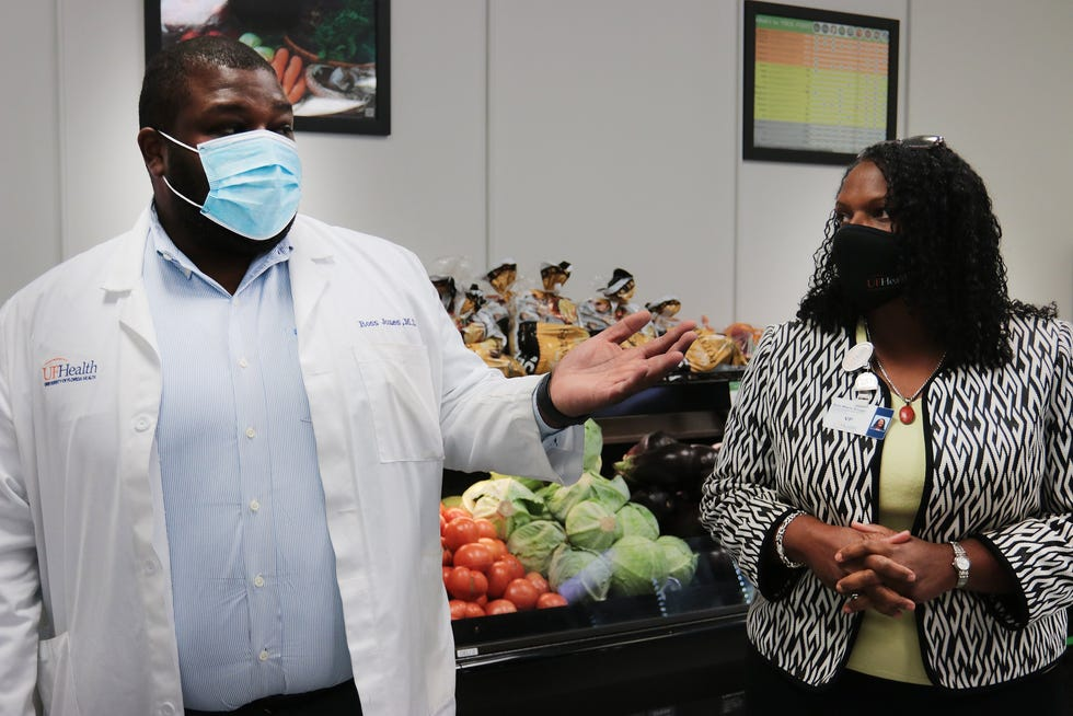 Ann-Marie Knight, vice president of Communication Engagement and chief diversity officer at UF Health Jacksonville, and Ross Jones, medical director of Total Care Group and Community Health at UF Health Jacksonville, give a tour of the new Urban Health Alliance Social Services Hub and Food Pharmacy on June 10.