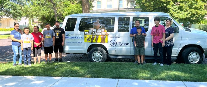 A $10,000 grant from Tyson Foods' Holcomb plant has helped the Real Men Real Leaders organization to purchase a van to be used to transport the organization's participants.