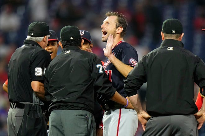 Washington Nationals pitcher Max Scherzer reacts as he talks with umpires during a foreign substances check in the middle of the fourth inning of a game against the Philadelphia Phillies, Tuesday, June 22, 2021, in Philadelphia.