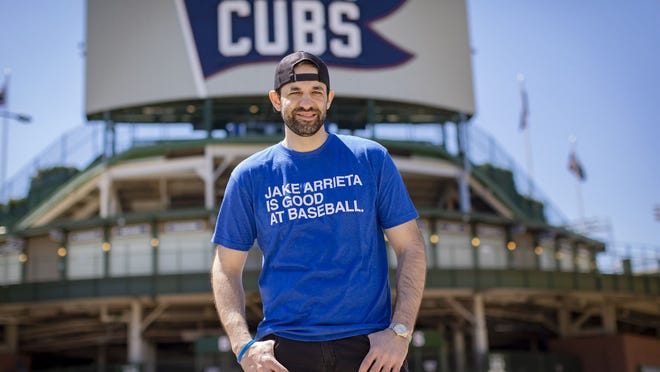 Joe Johnson, the founder of Obvious Shirts, wears the original T-shirt on May 5, 2021, outside Wrigley Field in Chicago.