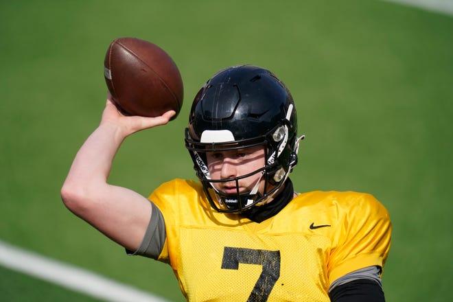 Iowa quarterback Spencer Petras (7) throws a pass during practice on Saturday, April 17, 2021, in Iowa City, Iowa.
