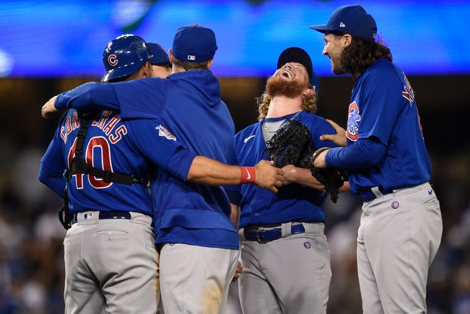 The Chicago Cubs celebrate a combined no-hitter after the final out by relief pitcher Craig Kimbrel, second from right, after a game against the Los Angeles Dodgers in Los Angeles on Thursday, June 24, 2021. The Cubs won 4-0.