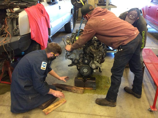 Students in the Diesel/Heavy Equipment Mechanics program at Careerline Tech Center worked to repair fellow student Gavin McClain's truck during the second semester this year.