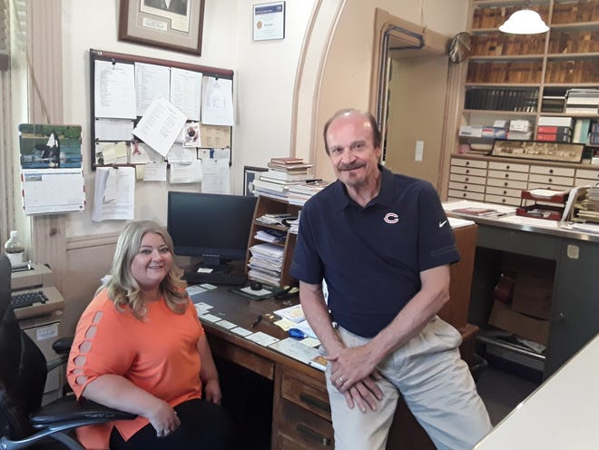 Tina Dolder tries out the office chair now occupied by County Clerk and Recorder Dan Kuhn, whom she'll be succeeding July 1 when he retires after nearly 19 years in office. She'll be the first woman to hold the office in Putnam County's 190-year history, Kuhn said