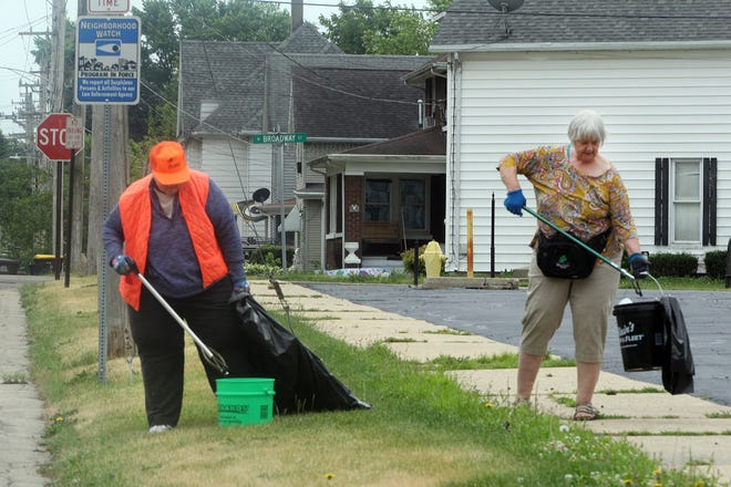 Kathy Wilken, left, and Cindy Bielefeldt, members of the Pretzel Pickers, pick up trash on Thursday, June 24, 2021, in Freeport. The local group started with three members, growing to 83 since April to be part of keeping Freeport neighborhoods free of litter.