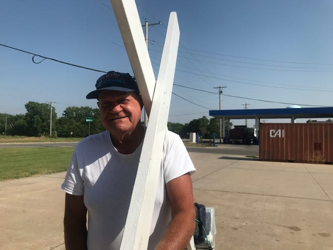 Roger Gates is headed across the nation with a cross on his shoulder, raising funds for a food ministry.