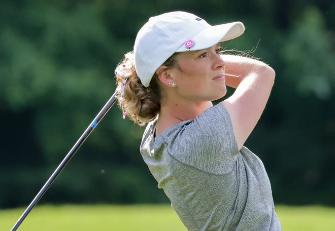 Canton native Madison Reemsnyder watches a drive fly during the third round of the Hudson Junior Invitational Thursday at The Country Club of Hudson. Reemsnyder won the girls tournament title with a score of 1-under par.