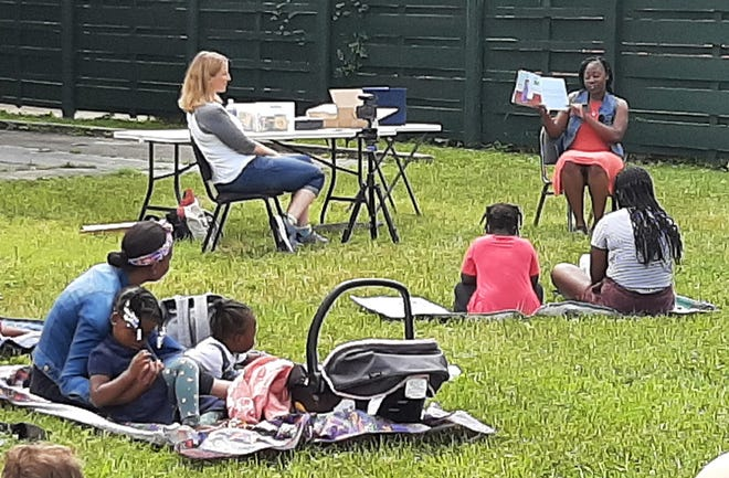 """MACOMB — Local author and first grade teacher Adrienne C. Graham read her book, """"The Color of Friendship"""" to an audience of local children and adults outside the Macomb Public Library on Tuesday. The reading was the first of three free public events featuring Graham, her book and related child-friendly activities. The appearances have been organized by One Human Family Macomb and the local venues where she is appearing. Graham will also appear in Chandler Park by Nostalgia at 10:30 a.m. July 24 and at the Western Illinois Museum at 6 p.m. on August 12."""