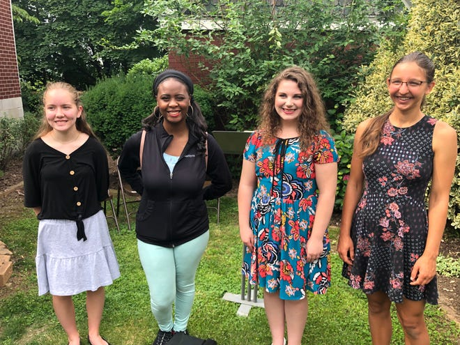 Olivia Marchbank (who received the award for her sister, Elizabeth), Ashlynn Cooper, Ava Breighner, and Sofiia Kucher were among the winners of the Allegany County Equal Justice Initiative essay contest. Not pictured was Robert Moffett.