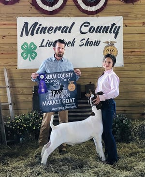 Harleigh Oswood had the Grand Champion Goat this week at the Mineral County Fair. Also pictured is judge Kyler Myers.