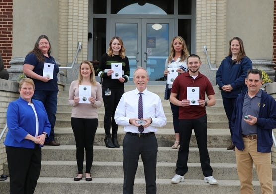 WVU Potomac State College recently awarded Value Coins and certificates to employees exemplifying WVU's Core Values of Service, Curiosity, Respect, Accountability, and Appreciation. Eight of the 12 recipients are pictured with campus president Jennifer Orlikoff (first row, far left): Gerald Wilcox and Phil Douthitt, (second row) Lesley Stark and David Shoemaker (third row) Marie Post, Rachel Raschella, Diana Niland, and Amanda Renick. Not pictured are Mark Harsh, Beth Little, Don Schafer and Cynthia Hartman.