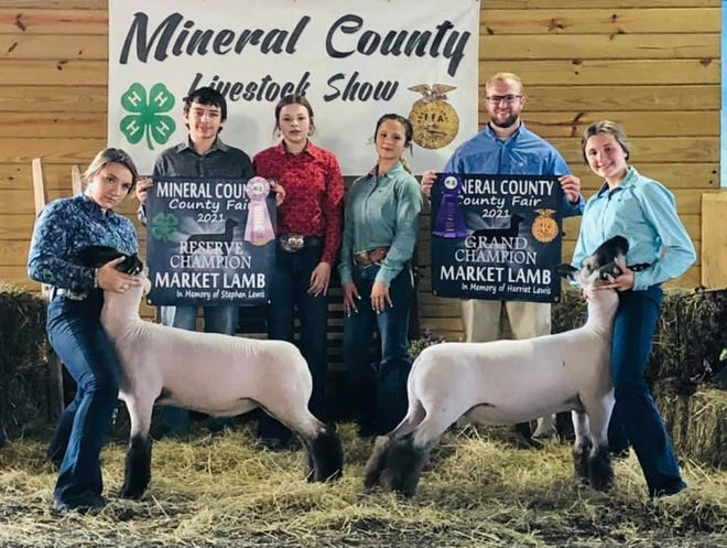 Audrey Williams (right) had the Grand Champion Market Lamb and Gracie Moncrief had the Reserve Champion at the Mineral County Fair.