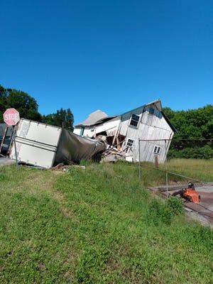 The scene in Oriskany Falls where a tractor-trailer plowed into a barn Thursday.