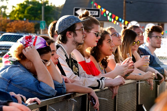 Fans listen as The Ivy performs during the 2018 Norman Music Festival on Friday, April 27, 2018 in Norman, Oklahoma.