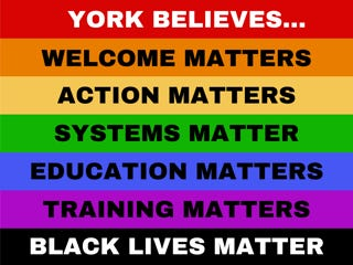 """The Committee to Combat Racism and Bias created a """"York Believes"""" yard sign as a part of a public art campaign."""