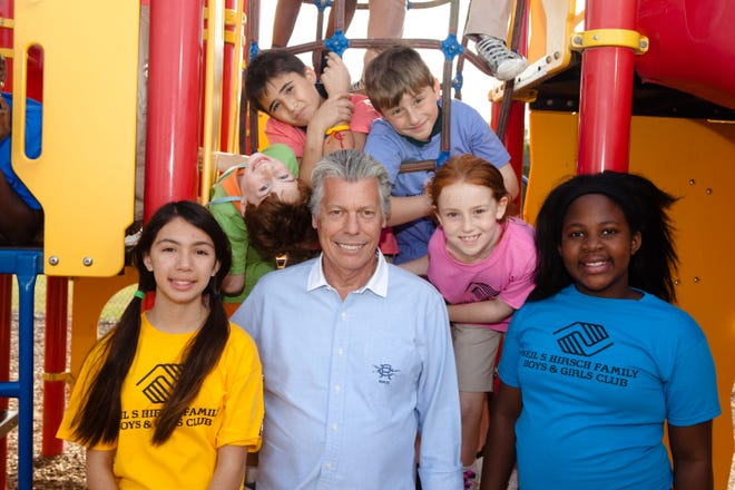 Neil Hirsch and club members at the opening of the Neil S. Hirsch Boys & Girls Club of Wellington in 2013.