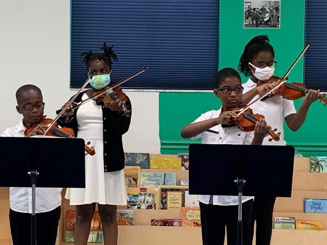 Boys & Girls Club of Delray Beach members perform a live violin recital at the club in June 2021.
